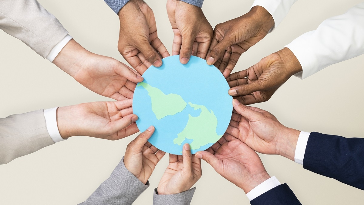 Hands holding earth CSR business campaign